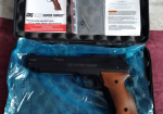 Overview image - Pistol with its instructions and paperwork